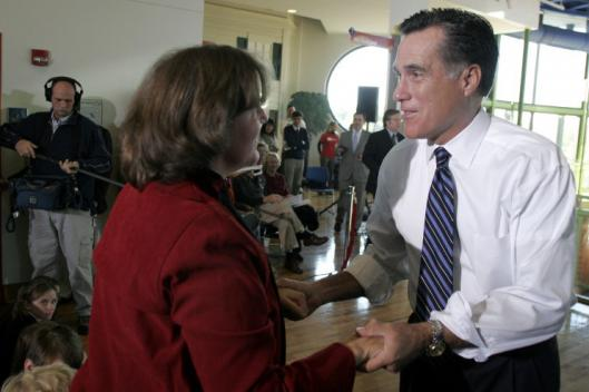 Former governor Mitt Romney spoke with Heather Krueger, a second cousin, at a campaign stop in Columbia, S.C., yesterday.