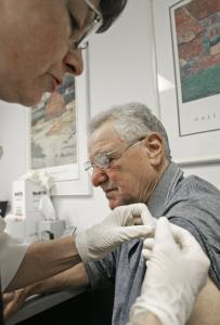 Donna Muehlenbruch gives an injection to Mario Musachia in Madison, Wis., as part of a trial of an antismoking vaccine.