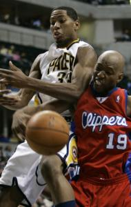 Clippers guard Sam Cassell knocks the ball away from Indiana's Danny Granger.