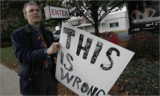 Aaron Ginsburg carries his message outside ''Bodies . . . The Exhibition.''