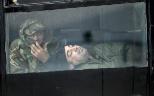 Government troops rested in a bus in Tblisi yesterday, a day after President Mikhail Saakashvili declared the emergency.