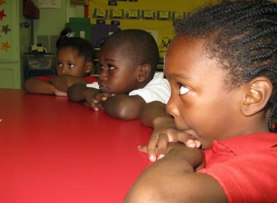 (From left) Shatarya McGhee, DeMontray Houston, and Tyonza Thompson are students at struggling Como Elementary.