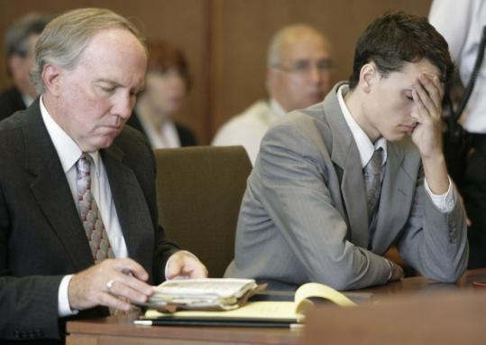 Tobin Kerns (right), 19, was found guilty of plotting a massacre at a school in September. His lawyer, William McElligott, sat at his side.