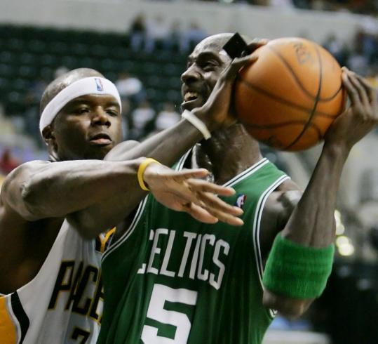 This is a reach: The Celtics' Kevin Garnett gets fouled by Indiana's Jermaine O'Neal as he goes up for a shot in the second quarter.