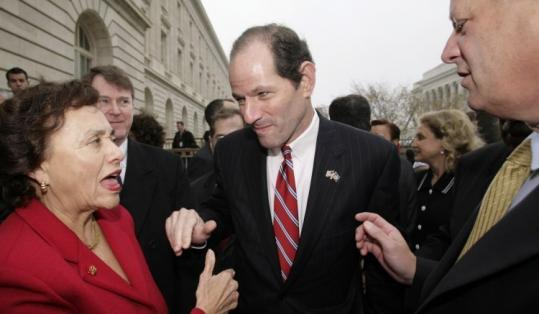 Governor Eliot Spitzer of New York bowed to foes and dropped a plan to offer driver's licenses to illegal immigrants. Rivals of Hillary Clinton had pounded her on the issue.