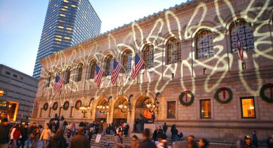 Festive shapes projected on the side of the Boston Public Library greeted visitors and passersby on New Year's Eve.