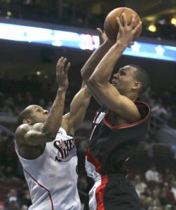 Portland's Brandon Roy (25 points) goes up and over Andre Iguodala.