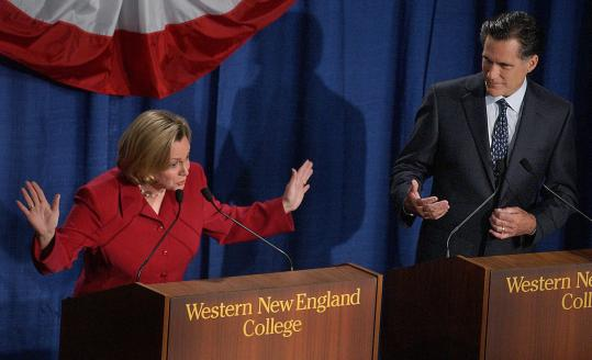 Shannon P. O'Brien and Mitt Romney faced off at Western New England College in Springfield during one of their five debates. O'Brien said she has given campaign videos of Romney, which she had kept in her basement, to the Democratic Party.