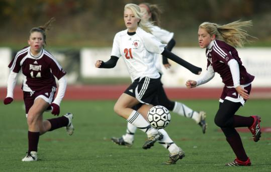 Bethany Frazier (center) plays keep-away from Millbury's Katie Nasuti (left) and Dannielle Mitchell.