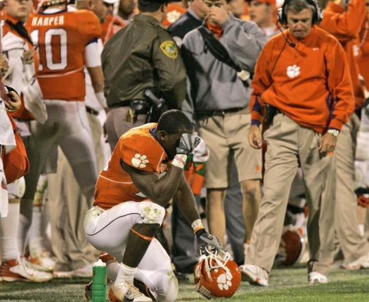 Coach Tommy Bowden (right) and C.J. Spiller (kneeling) want to look no longer as time ran out.