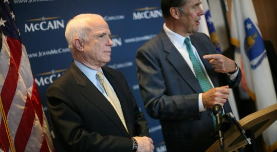 Thomas Kean (right), former New Jersey governor, endorsed Senator John McCain of Arizona at Logan International Airport.