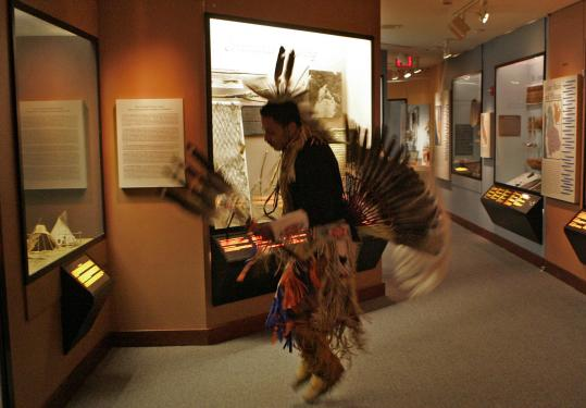 Pedro Fermino warmed up with a dance from the Mashpee Wampanoag yesterday before the 'crossroads' ceremony was held at a Harvard museum.