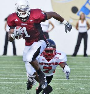 UMass wide receiver/punt returner J.J. Moore is a dynamic force when the ball is in his hands, as Northeastern's Enrique Cox found out earlier this season