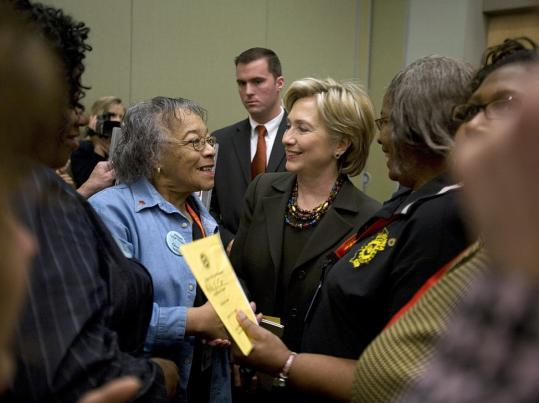 Hillary Clinton chatted with Ginny Nailing of Peoria, Ill., during a campaign stop Monday in Dubuque, Iowa. Analysts say she connects with working-class women by presenting an image as a fighter who has overcome obstacles in her life.