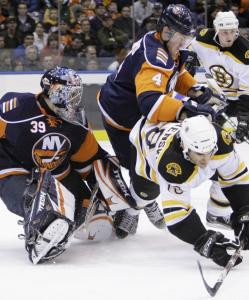 Brandon Bochenski and the Bruins were pushovers against Bryan Berard (4), goalie Rick DiPietro, and the Islanders.