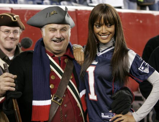 Victoria's Secret model Selita Ebanks with Steve Miller of Southborough, of the End Zone Militia, last night.