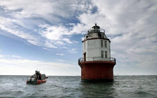 A Coast Guard vessel waited last week as nine would-be owners toured the dilapidated 102-year-old Point No Point lighthouse.