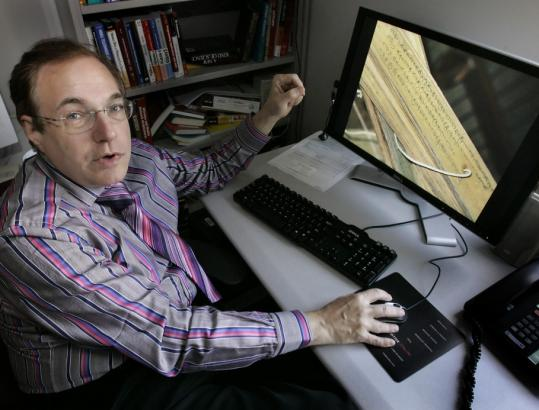 Michael Shamos, a Carnegie Mellon University professor, displays an old Indian manuscript that was scanned as part of the Million Book Project.