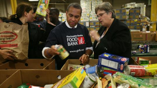 Governor Deval Patrick got some pointers yesterday on sorting donated food from Catherine D'Amato (right), president and CEO of the Greater Boston Food Bank.
