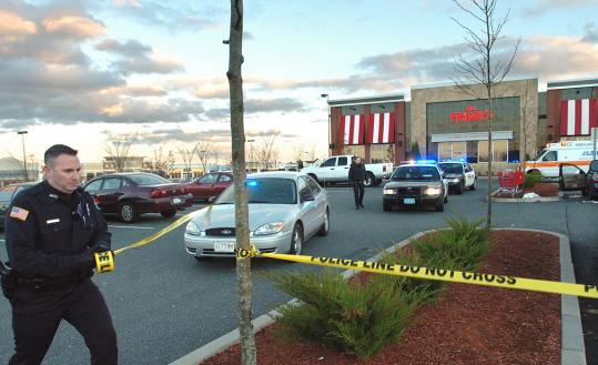 A police officer taped off a portion of the parking lot at the Shoppes at Blackstone Valley.