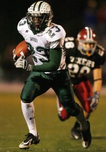 Dartmouth's Jordan Todman, who ran for 98 yards on 19 carries, breaks away from Brockton's Alex White.