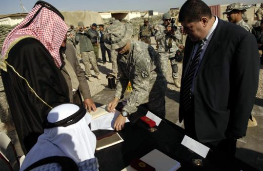 Sunni tribal leaders signed a security agreement in Hawija yesterday, joined by nearly 6,000 Sunni Arab residents in an alliance with US forces to help plug escape routes for extremists flushed from former strongholds. US officers describe this dusty farming community 150 miles north of Baghdad as the last gateway for militants flowing northward in Iraq.