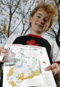 Meg Parson, with her orienteering map in Estabrook Woods in Concord.