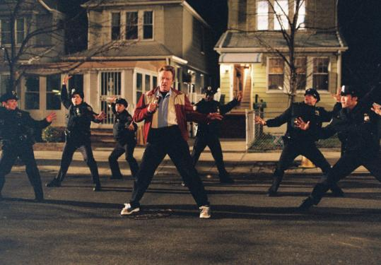 Christopher Walken leads policemen in a song in John Turturro's unusual musical.