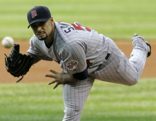 Two-time Cy Young Award winner Johan Santana went 15-13 with 235 strikeouts for the Twins last season.