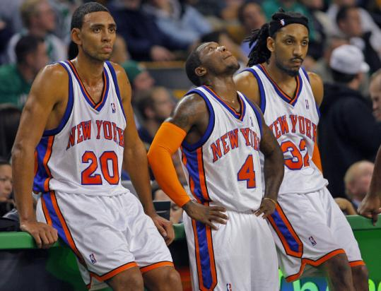 Exasperated Knicks Jared Jeffries (20), Nate Robinson, and Renaldo Balkman await their turn to get into the blowout.