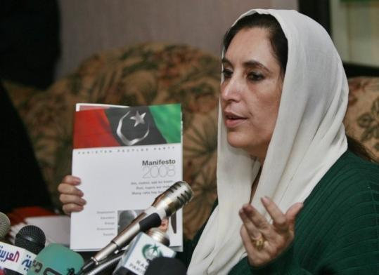 Benazir Bhutto showed her party's manifesto for the upcoming elections during a news conference in Islamabad yesterday.