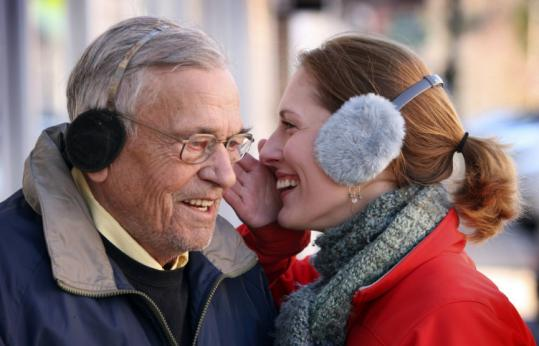 Rebecca LaRovera whispered to Sully Greenwood, a grandson of Chester Greenwood, who invented earmuffs in 1873.