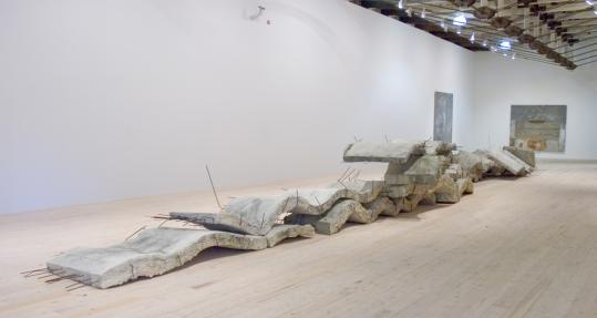 Anselm Kiefer's 'Etroits sont les Vaisseaux (Narrow Are the Vessels),' part ravaged city and part graceful ocean wave, is 80 feet long and weighs six tons.