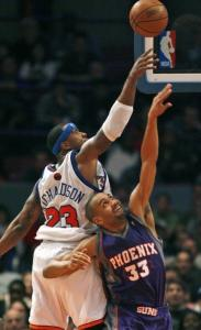 Quentin Richardson has the upper hand - but Phoenix's Grant Hill was the one who went home a winner.