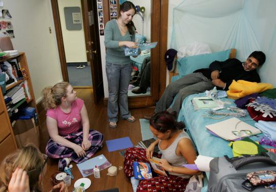 Alexandra Solimano passed out crafts materials for a holiday decorating program in her dormitory at Wellesley College. Her friend Mohammad Usman is the lone male student on campus.