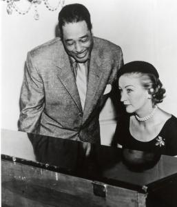 Duke Ellington in Newport with Mrs. Lorillard at a piano.