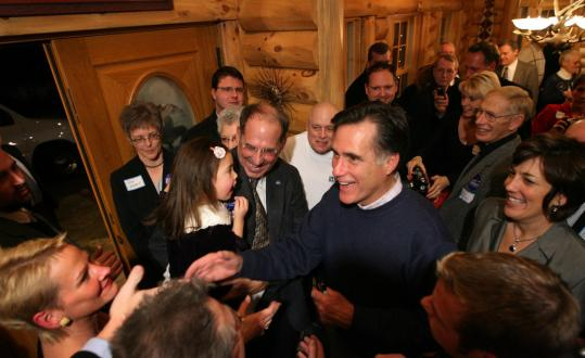 Mitt Romney met members of the Iowa Christian Alliance at a house party Friday in Dubuque.