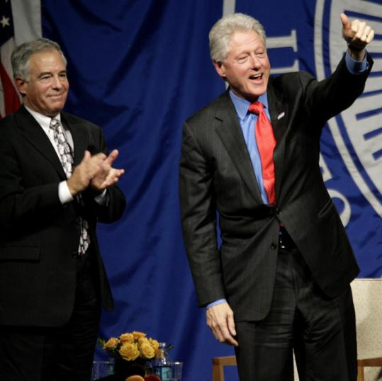 Brandeis's president, Jehuda Reinharz (left), and Bill Clinton at Gosman Sports and Convocation Center yesterday.