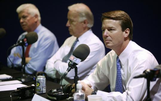 Democratic presidential candidates former senator John Edwards (from right) and Senators Joe Biden and Chris Dodd before the National Public Radio debate yesterday.