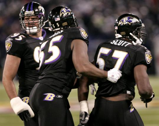 The Ravens' Terrell Suggs holds ba