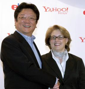 Yahoo Japan president Masahiro Inoue and eBay International president Lorrie Worthington celebrate the partnership.