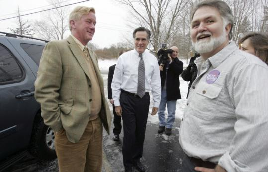 Republican presidential hopeful Mitt Romney (center), with former Massachusetts governor William Weld (left), in Windham, N.H., yesterday. Weld said his running mate and successor, Paul Cellucci, was mistaken last week when he assailed Romney over tax cuts and spending.