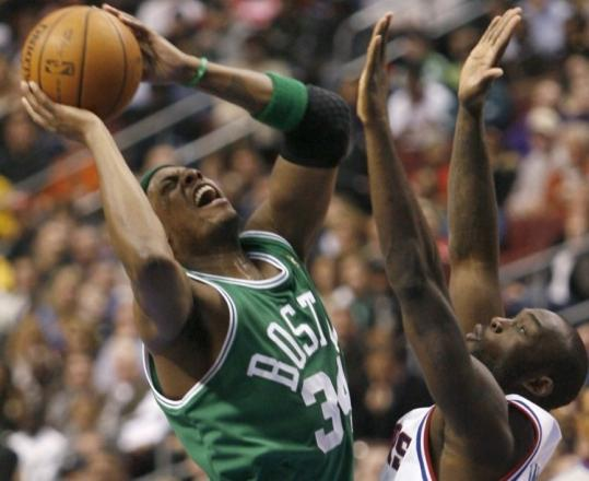 A little pressure from Philadelphia's Reggie Evans doesn't deter Paul Pierce (19 points) from taking this shot.
