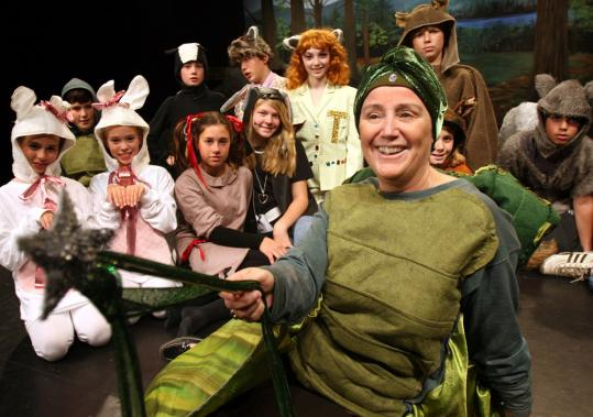 Andrea Archer, head of Derby Academy, plays the Tortoise Fairy Godmother in the 'The Tortoise and the Hare.'