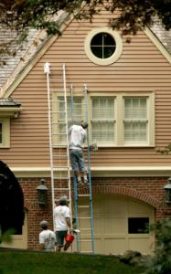 A crew from Olympic Painting and Roofing of Peabody at work on the Belmont home of former governor Mitt Romney in October.
