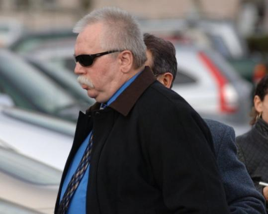 Timothy Elliott, who won a $1 million lottery prize, leaves Barnstable Superior Court after a hearing yesterday.