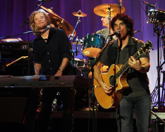 Daryl Hall and John Oates performed Christmas songs and classic hits - and dealt with technical issues and booing - during Saturday's show.