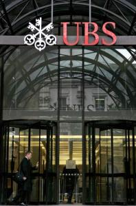 UBS said it plans to raise billions through share sales to Singapore and a Middle East investor.