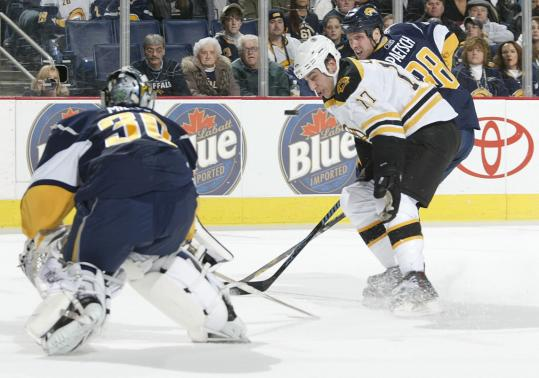 Ever-improving Milan Lucic spent a lot of time pestering Sabres goalie Ryan Miller Monday.