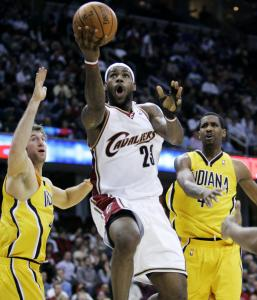 Protective glove on his left hand, LeBron James drives through the Pacers in the second quarter on the way to 2 of his 17 points.